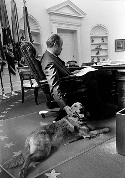 Gerald R. Ford with his dog Liberty in the Oval Office