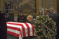With her four children behind her Mrs. Ford pauses at the casket of her husband of forty-two years during funeral events for President Ford at the U.S. Capitol. January 1, 2007.