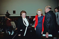 Congresswoman Mary Rose Oakar (D-OH) greets Betty Ford as she arrives to testify before the Select Committee on Aging Subcommittee on Health and Long-Term Care in support of public spending and insurance coverage for substance abuse treatment programs such as those offereed by the Betty Ford Center. March 25, 1991.