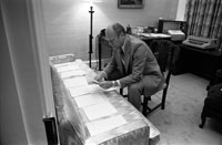 President Ford examines documents related to potential Vice Presidential nominees in the office of his Counsellor, Robert T. Hartmann. August 15, 1974.
