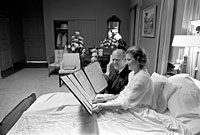 President Gerald Ford and First Lady Betty Ford read a petition, signed by all 100 members of the United States Senate, in the President's Suite at Bethesda Naval Hospital, Bethesda, MD