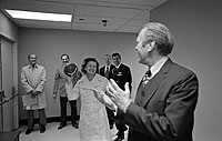 President and Mrs. Ford toss a football, a gift from Washington Redskins Coach George Allen, in the hallway near the Presidential Suite at the Bethesda Naval Hospital, Bethesda, MD