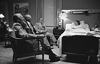 President Ford, Bob Hope and an unidentified man visit Mrs. Ford at the Bethesda Naval Hospital