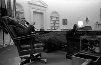 President Ford takes a call after delivering his Address on the Economy to a Joint Session of Congress.  Oval Office.  October 8, 1974.