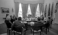 President Ford meets with his senior staff prior to the second press conference of his presidency.