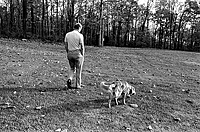 President Ford and his dog Liberty walk the grounds of Camp David