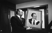 President Ford examines a wood portrait of himself given by Soviet General Secretary Leonid Brezhnev.  Okeansky Sanatorium.