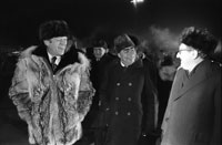 Just moments after this photo was taken, President Ford informally concluded the Vladivostok summit by giving his wolfskin coat to Secretary Brezhnev on the tarmac at Vozdvizhenka  Airport.