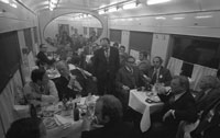 President Ford and his staff dine on a Soviet train enroute to Vozdvizhenka Airport, near Vladivostok, USSR. November 24, 1974.