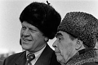 Soviet General Secretary Leonid Brezhnev greets President Ford upon his arrival at Vozdvizhenka Airport. November 23, 1974.