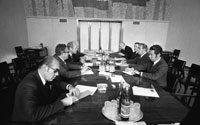 A meeting on the second day of the summit was attended by [l-r] interpreter Mr. Akalovsky,  Secretary of State Henry Kissinger, President Ford, Ambassador Walter Stoessel, Ambassador Anatoly Dobrynin, Foreign Secretary Andrei Gromoyko, Secretary Leonid Brezhnev and his personal interpreter Victor Sukhrodev.