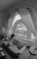 First Lady Betty Ford gazes toward the Oval Office from a window in the White House residence.
