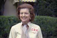 First Lady Betty Ford sports a button expressing her support for ratification of the Equal Rights Amendment while taking some personal time as President Ford plays in the Jackie Gleason Inverrary Classic Celebrities Golf Tournament.  Inverrary Country Club, Hollywood, Florida.   February 26, 1975.