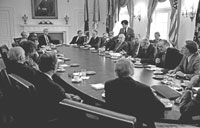 President Ford briefs the Republican Congressional Leadership on the situation in Indochina. Defense Secretary James Schlesinger and Secretary of State Henry Kissinger are seated at the far end of the table.  Cabinet Room.  April 22, 1975.