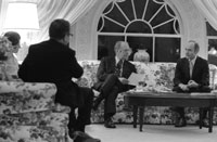 President Ford discusses the evacuation of Saigon with Secretary of State Henry Kissinger and his Deputy Assistant for National Security Affairs Brent Scowcroft during a late night meeting in the White House residence. April 28, 1975.