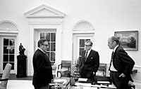 President Ford meets in the Oval Office with Secretary Kissinger and Vice President Rockefeller to discuss the American evacuation of Saigon