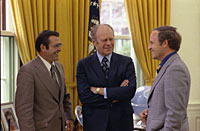 President Ford chats with Chief of Staff Donald Rumsfeld and Rumsfeld's assistant Richard Cheney in the Oval Office
