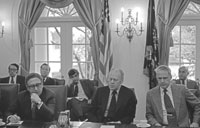 President Ford, Secretary of State Henry A. Kissinger (left) and Secretary of Defense James R. Schlesinger (right) at a meeting with bipartisan congressional leaders to discuss the situation in South Vietnam.  Cabinet Room.  April 29, 1975.