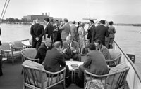 President Ford hosts an informal dinner and a Cabinet meeting aboard the presidential yacht, the USS Sequoia.