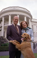 President and Mrs. Gerald R. Ford pose on the South Lawn of the White House with  Liberty, their pet golden retriever.