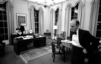 Departing early from a White House dinner in honor of Netherlands' Prime Minister, Johannes den Uyl, Secretary of State Henry A. Kissinger and Deputy Assistant for National Security Affairs Lt. Gen. Brent Scowcroft work into the night to monitor developments in the retaking of the S.S. Mayaguez.