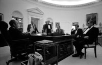 President Ford and senior staff members stay late into the night to learn of the recapture of the S.S. Mayaguez and its crew.