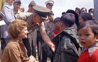 First Lady Betty Ford greets newly-arrived Vietnamese children at the Camp Pendleton Refugee Camp in California.  May 21, 1975.