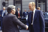 President Ford escorts Helmut Schmidt, Chancellor of the Federal Republic of Germany, to his limousine after a luncheon meeting at the American Embassy Residence.   Brussels, Belgium.  May 29, 1975.