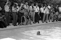President Ford takes his first swim in the new White House swimming pool.   July 5, 1975.