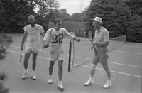 President Ford, Chief of Staff Donald Rumsfeld, and David Kennerly, Personal Photographer to the President, following a tennis match on the White House Tennis Courts.  (not shown Deputy Press Secretary Bill Greener, Jr.)   July 16, 1975.