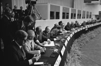 President Ford signs the Final Act of the Conference on Security and Cooperation in Europe as it is passed among European leaders for signature.  Finlandia Hall, Helsinki, Finland.  August 1, 1975.