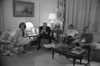 "President Ford and First Lady Betty Ford  and their sons Jack and Steve watch the television news of  attempt on the President's life by Lynette ""Squeaky"" Fromme, in Sacramento, California in the White House residence."
