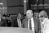 A6521-22A	President Ford winces at the sound of the gun fired by Sarah Jane Moore during the assassination attempt in San Francisco, California.