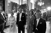 President and Mrs. Ford escort the Emperor (Hirohito, now Showa) and Empress of Japan to a white tie dinner held in honor of their first State Visit to the United States. October 2, 1975.