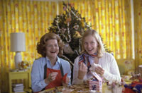 "Having selected ""handmade and folksy"" as the theme for Christmas at the White House, First Lady Betty Ford makes homemade ornaments with daughter Susan for the tree in the third floor Solarium during a photo-op for Parade Magazine.  November 10, 1975."
