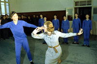 While touring the Central May 7th College of Art in Peking, People's Republic of China, First Lady Betty Ford shares a dance move with one of the students.