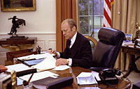 President Ford at work in the Oval Office. January 27, 1976.