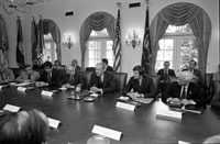 President Ford conducts a meeting to discuss a Federal initiative to immunize all Americans against the swine flu influenza.