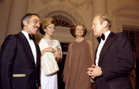 President and Mrs. Ford say goodnight to King Hussein and Princess Alia of Jordon as they depart the White House after a state dinner in their honor.  March 30, 1976.