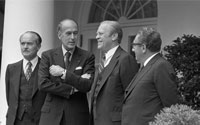 Prior to their Oval Office meeting President Ford and French President Valery Giscard d'Estaing stand on the White House Colonnade along with Secretary of State Henry Kissingerand French Foreign Minister Jean Sauvagnargues.   May 17, 1976.