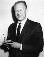 Representative Gerald R. Ford, Jr., poses with his Sports Illustrated Silver Anniversary Award