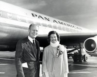 Gerald and Betty Ford pose for a photograph at an unidentified airport. Mrs. Ford was wearing a neck brace for pain. 1964.