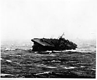 The USS Monterey founders during a typhoon in December 1944