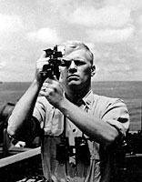 Navigation Officer Gerald R. Ford takes a sextant reading aboard the USS Monterey