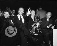 Congressman Gerald Ford and wife Betty attend a Grand Rapids campaign event with presidential candidate Dwight D. Eisenhower and his wife Mamie. October 1, 1952.