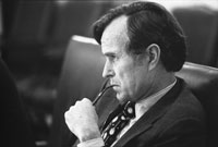 CIA Director George H.W. Bush listens intently at a National Security Council meeting following the assassinations in Beirut of U.S. Ambassador to Lebanon Francis E. Meloy, Jr. and Economic Counselor Robert O. Waring on June 16.  June 17, 1976.