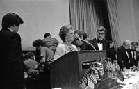 First Lady Betty Ford offers a prayer for Jewish National Fund president Rabbi Maurice Sage who collapsed onstage from a heart attack just before presenting her with a Bible at the Fund's gala dinner to inaugurate the American Bicentennial National Park in Israel.   June 22, 1976.