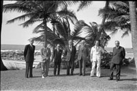 The participants in the Second International Economic Summit Conference gather under the palms for a press photo. Dorado Beach, Puerto Rico. June 27, 1976
