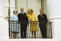 President and Mrs. Ford and Her Majesty Queen Elizabeth II and Prince Philip on the Truman Balcony following the Queen's state arrival at the White House.