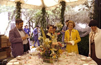 First Lady Betty Ford observes the table settings and staff preparations for the evening's state dinner in honor of Queen Elizabeth II of England and Prince Philip.  July 7, 1976.